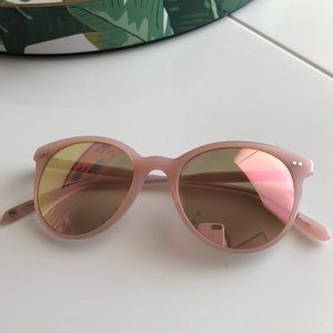 Garrett Leight pink sunglasses with mirror lenses